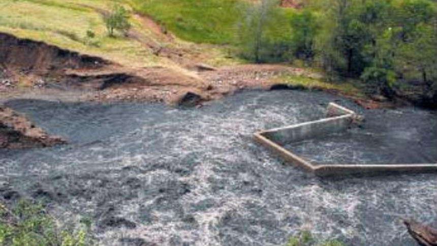Flooding From Excessive Rain Downstream From Earth Dams